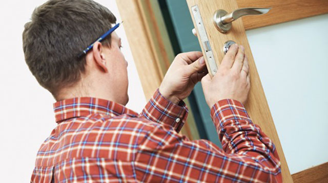 locsmith working on a door lock Improving safety and security